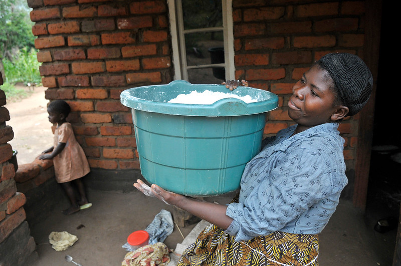 Drying maize flour in Malawi